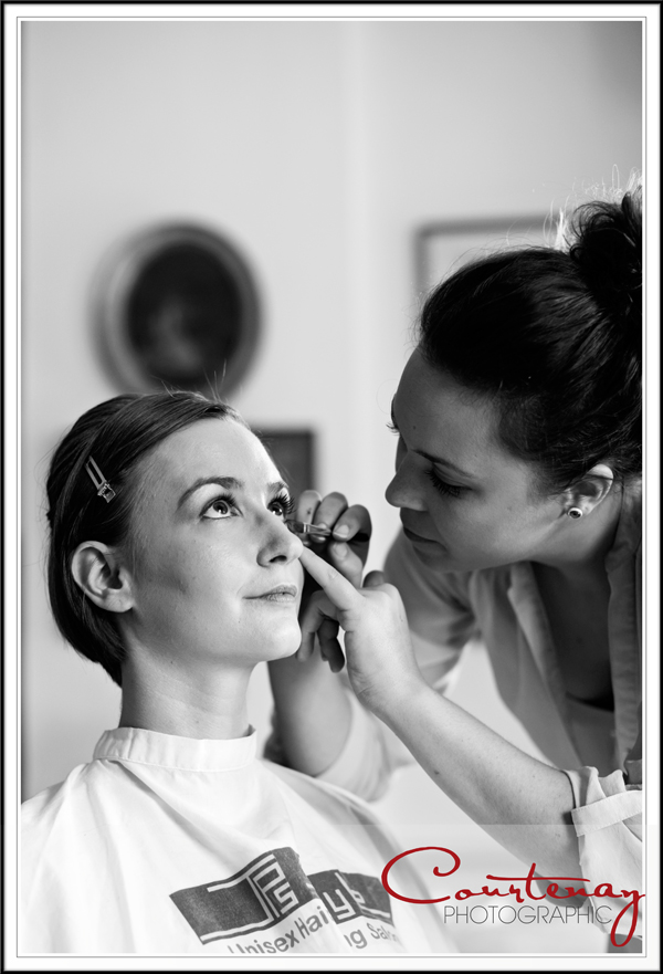 Bride having her make up done at smedmore house in dorset