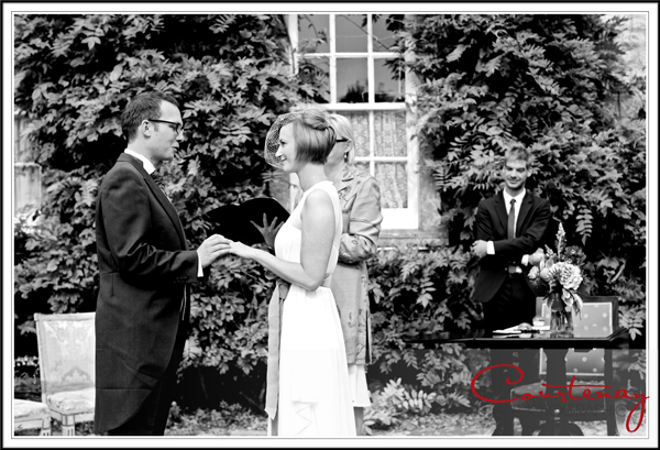bride and groom exchange vows in smedmore house gardens