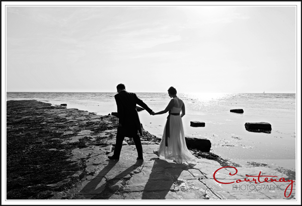bride and groom down by the sea at kimmeridge bay