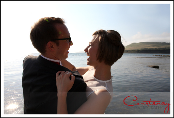 bride and groom celebrating on the jurassic coast