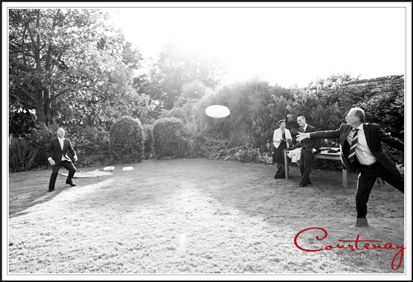 frisbee on the lawn at dorset wedding
