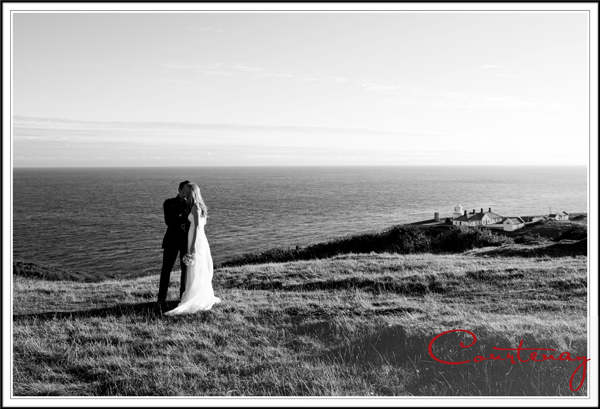 Bride & Goom sneak a romantic moment above Anvil point Lighthouse on Dorsets Jurassic coast