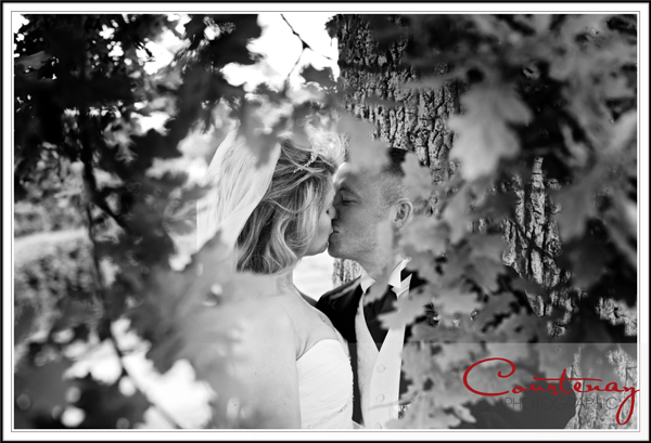 Bride & Groom take a romantic kiss at Victorian Barn wedding Dorset