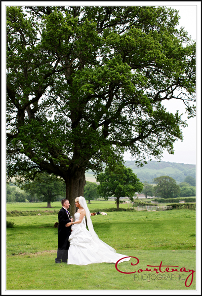 Bride & Groom take a romantic moment at Victorian Barn wedding Dorset