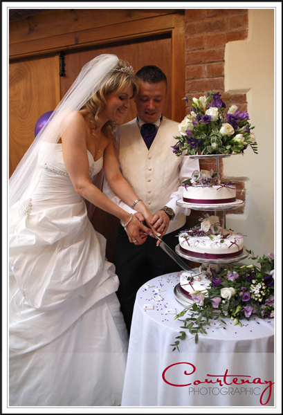 Bride & Groom Cut the wedding cake at Victorian Barn wedding Dorset